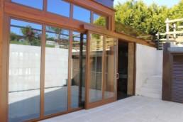 Muros cortina mixto madera y aluminio